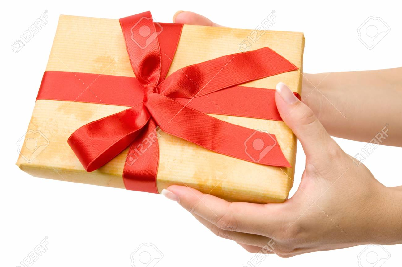 Female hand holding an ornamented gift. Isolated on a white background. - 2097689