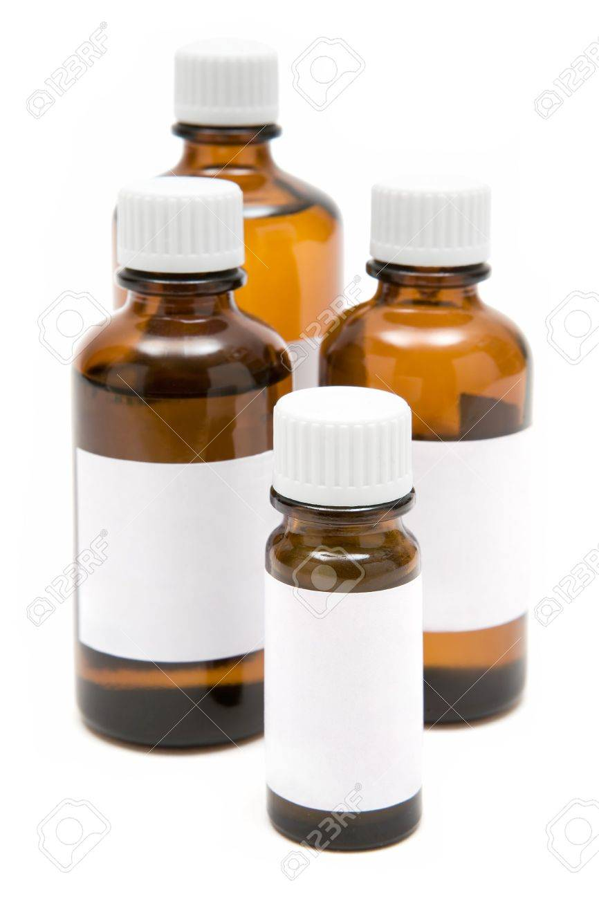 Several medicine bottles with blank labels isolated on a white background. - 2557462