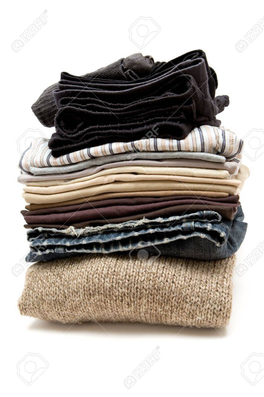 Stack of various clothes. White background. - 2705884