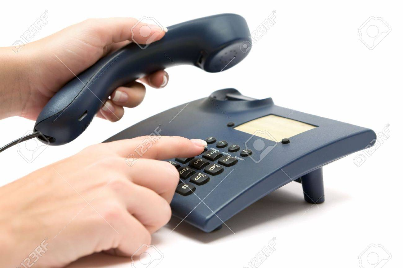 Dialing a number on a blue phone. White background. - 2783211