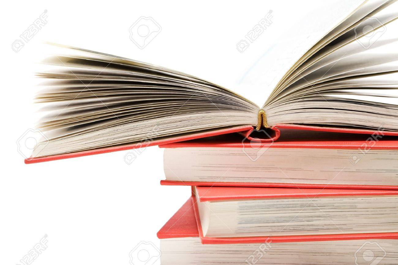 Open book on top of several stacked novels. Isolated on a white background. Stock Photo - 2996266