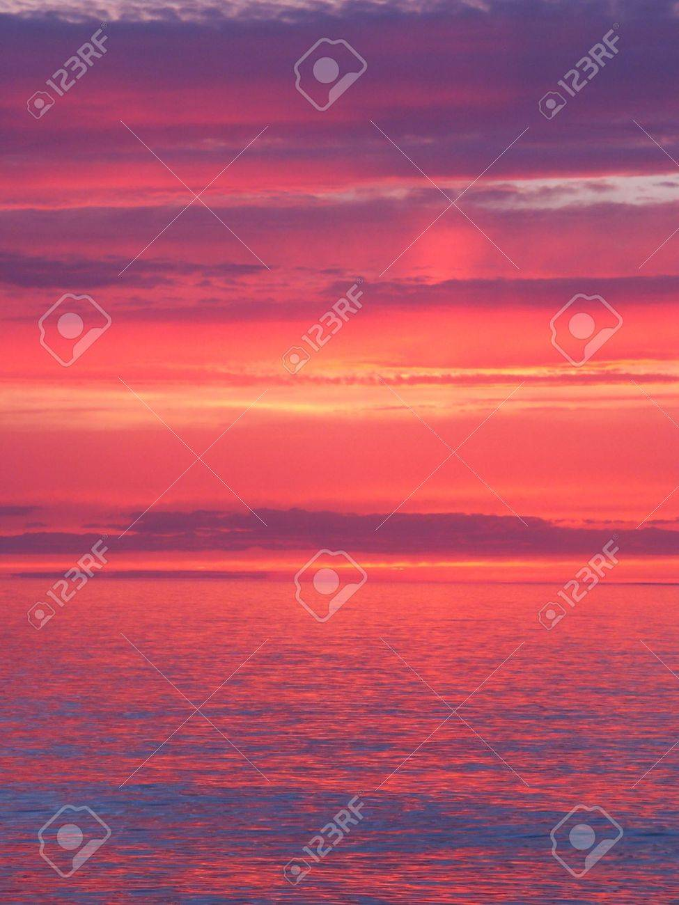 Beautiful pink colors reflect off Lake Superior in northern Michigan. Stock Photo - 7926722