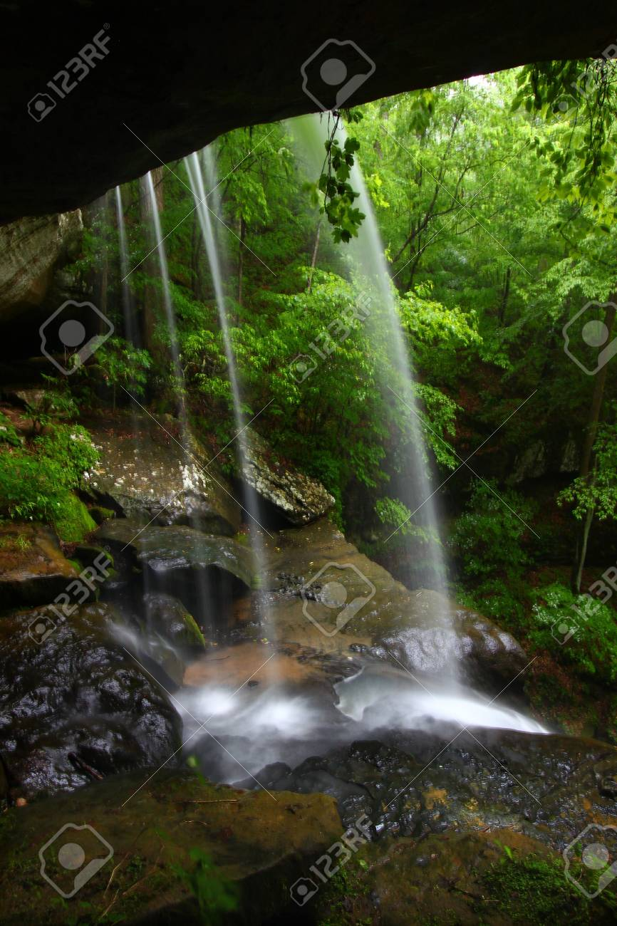 View from behind a tranquil waterfall on Cane Creek in northern Alabama Stock Photo - 8490451