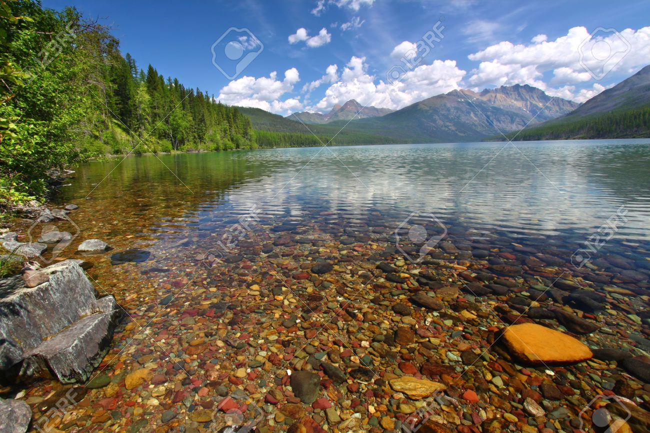 Brightly colored rocks seen through the crystal clear waters of Kintla Lake in Glacier National Park - USA Stock Photo - 10554382