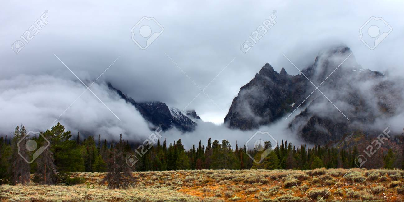 Clouds hang over jagged peaks of the Teton Range in western Wyoming Stock Photo - 11941219