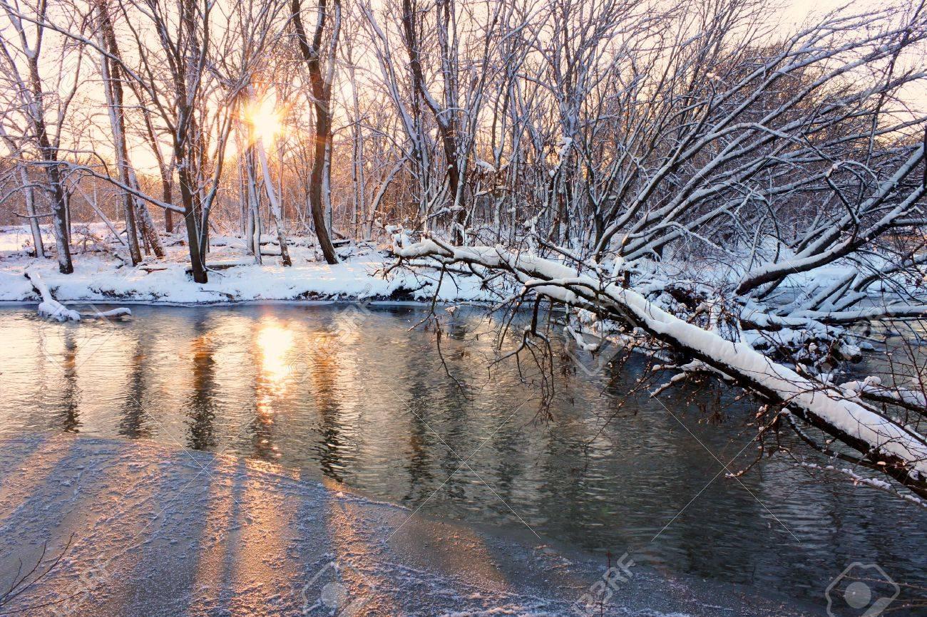 Light of sunset sparkles off the Kishwaukee River in northern Illinois Stock Photo - 12202558
