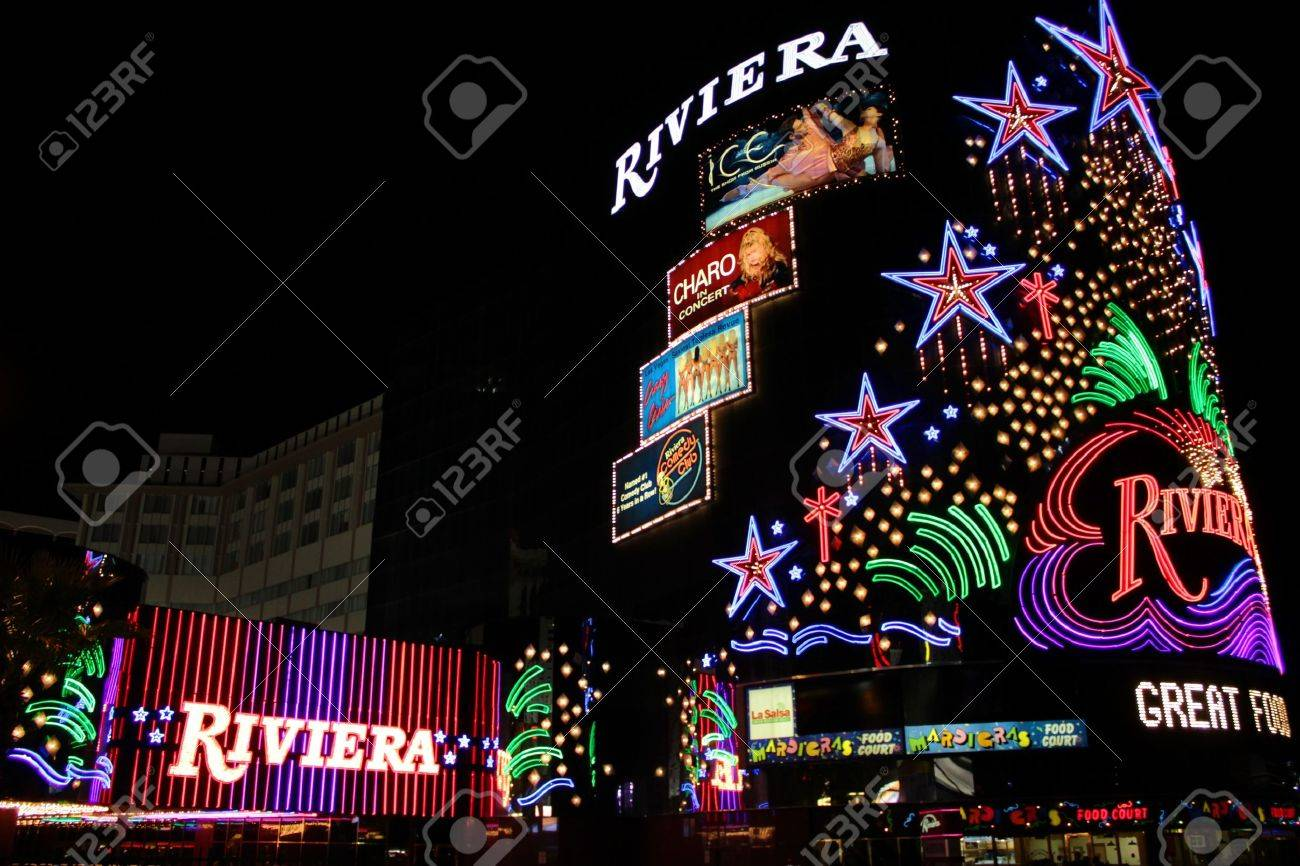 Las Vegas, USA - August 26, 2009: The Riviera Hotel and Casino is one of the first flashy hotel casinos to open on Las Vegas Boulevard in 1955.  Seen here is the brightly decorated sign near the main entrance to the building. Stock Photo - 13626978