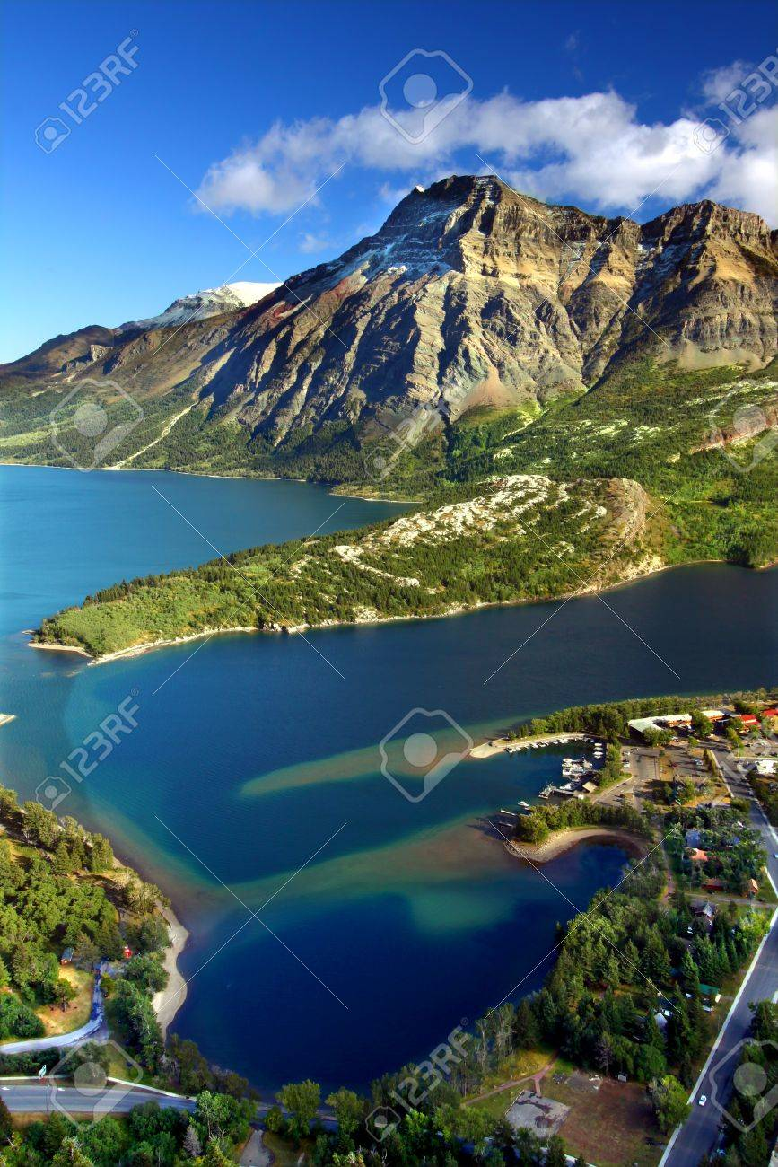Sweeping view over blue waters and rugged mountain peaks of Waterton Lakes National Park in Canada Stock Photo - 13678265