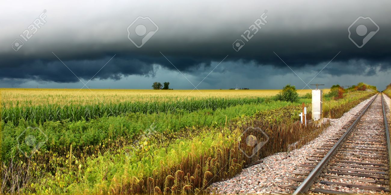 Thunderstorm over railroad tracks and corn fields of northern Illinois - 15506434