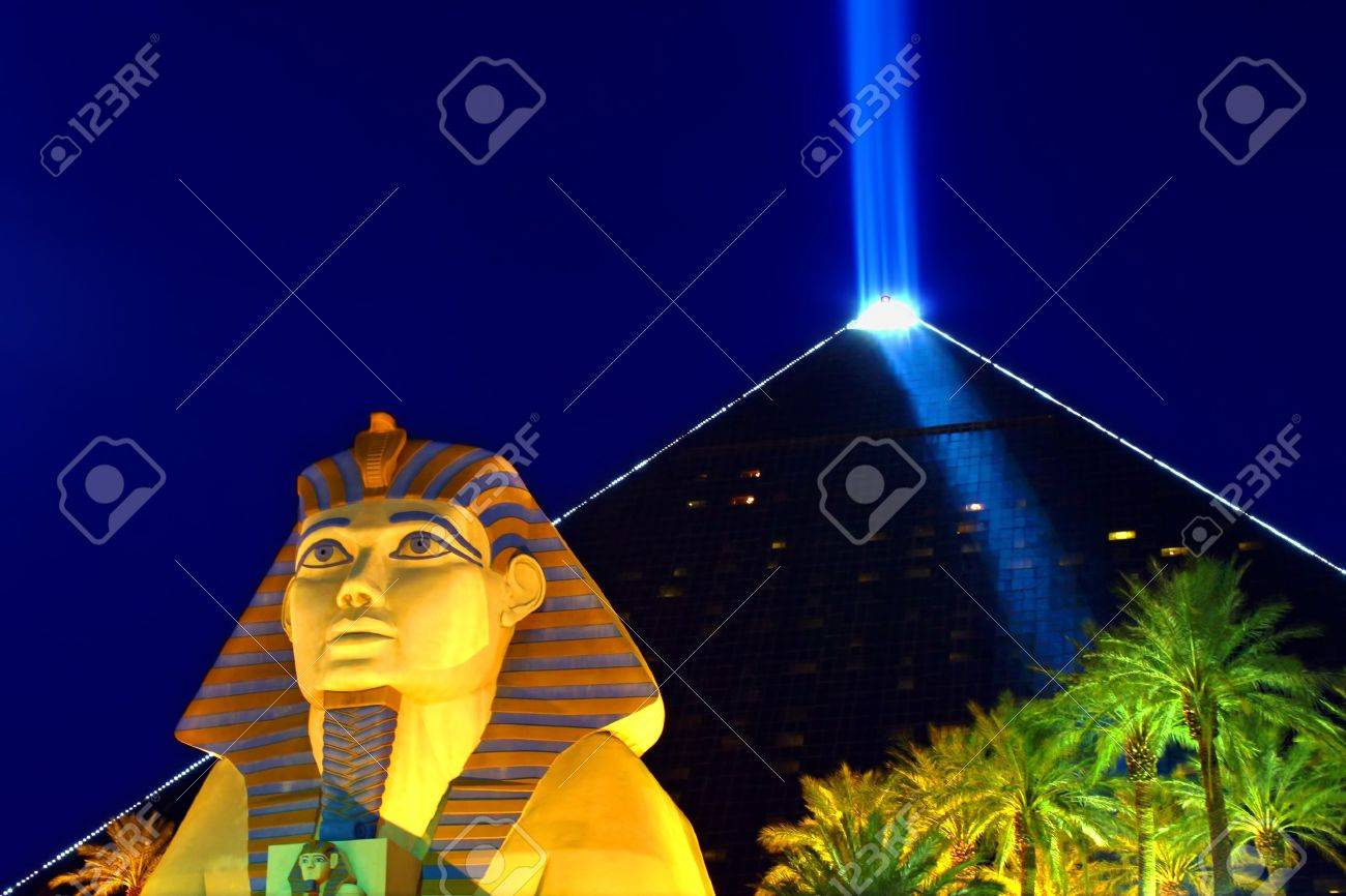 Las Vegas, USA - October 29, 2011: Luxor Las Vegas is an Egyptian themed hotel and casino on the famous Las Vegas Strip.  The hotel was opened in 1993 and contains a replica of the Great Sphinx of Giza and a pyramid shaped building with a spotlight. Stock Photo - 16223460