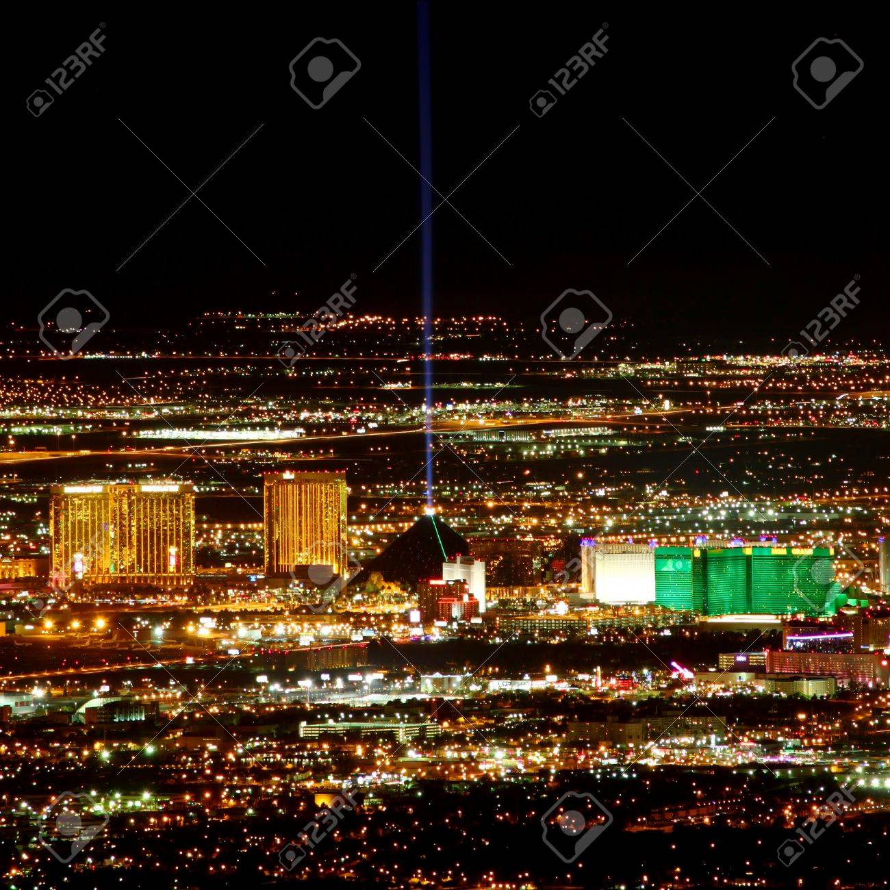 Las Vegas, USA - November 26, 2011: Bright lights of hotels and casinos at the south end of the Las Vegas Strip. The Strip is about 4 miles long and is seen here from the Frenchman Mountain summit. Stock Photo - 16285718