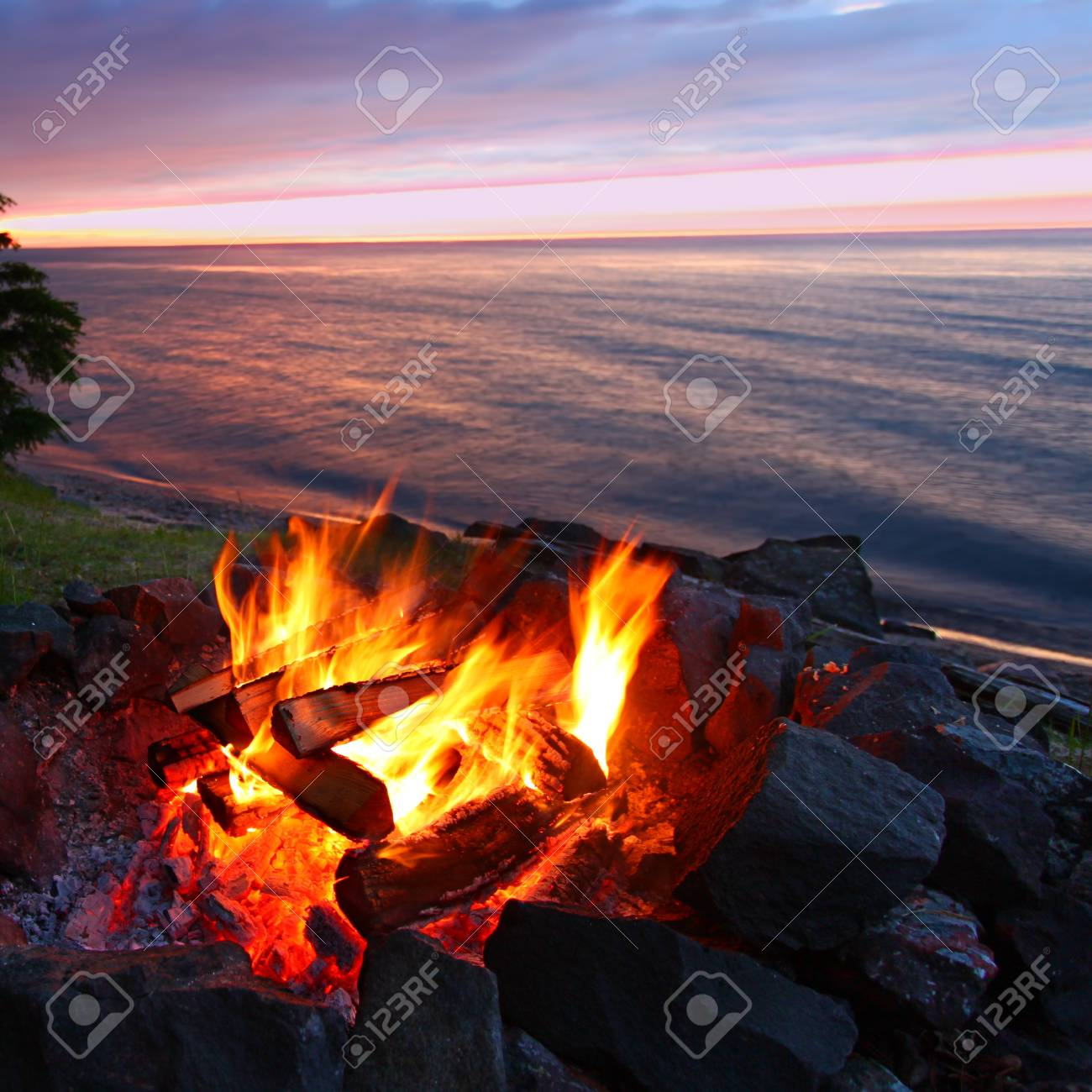 Sunset camp fire along the beautiful beach of Lake Superior in