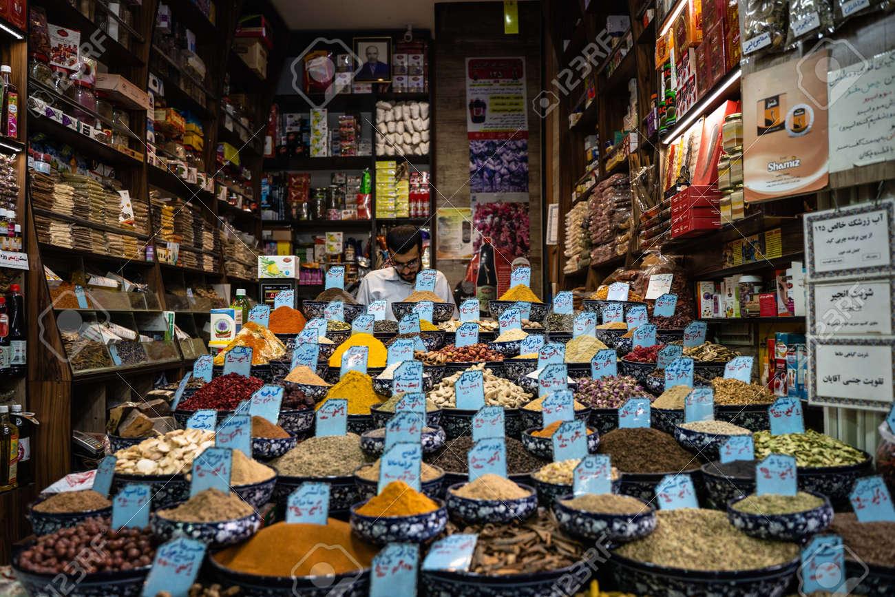 CHIRAZ, IRAN - Oct 28, 2019: Spice seller in the bazaar of Chiraz - 155113626