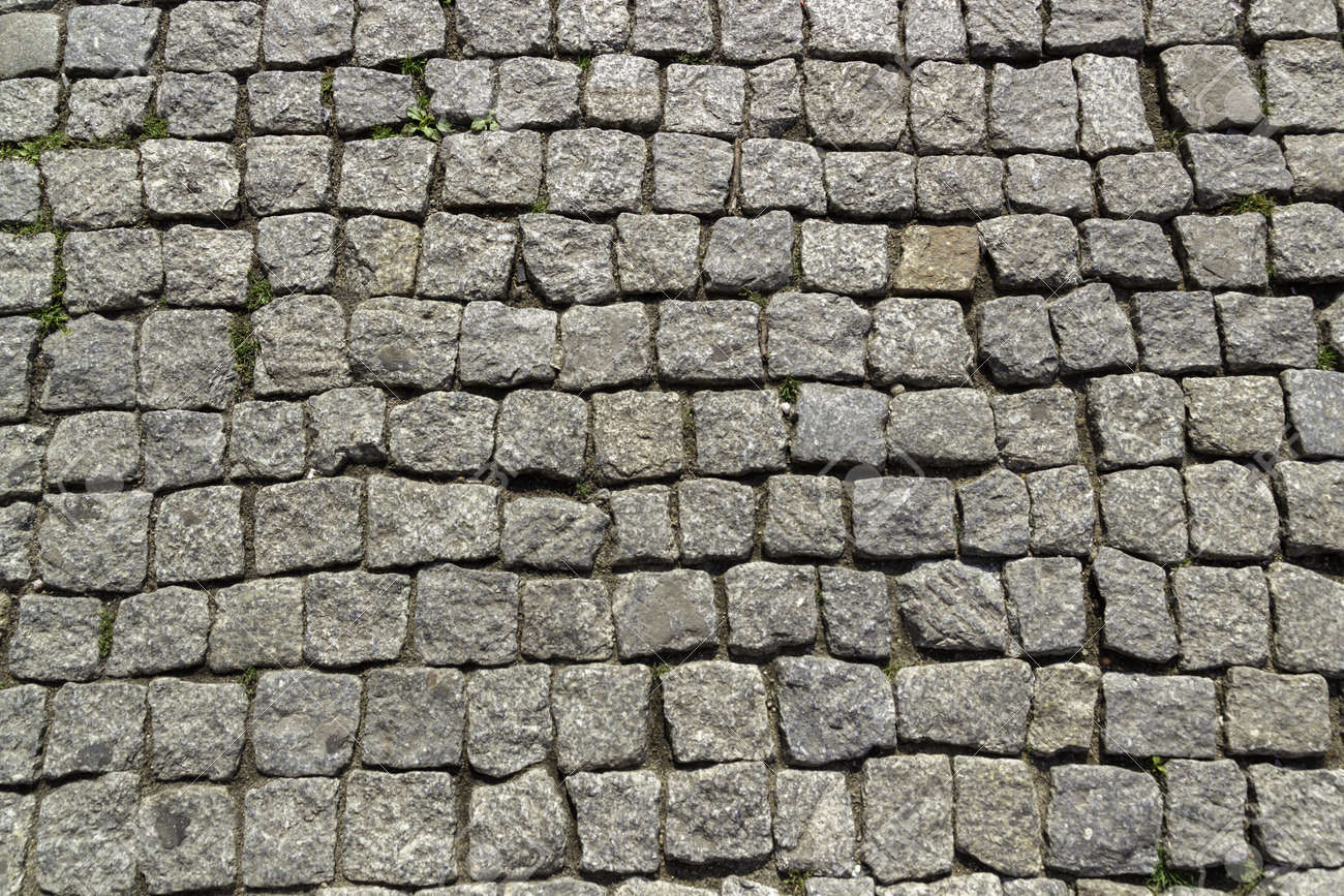 A closeup of a cobblestone road under the sunlight - a nice picture for backgrounds and wallpapers - 155875194