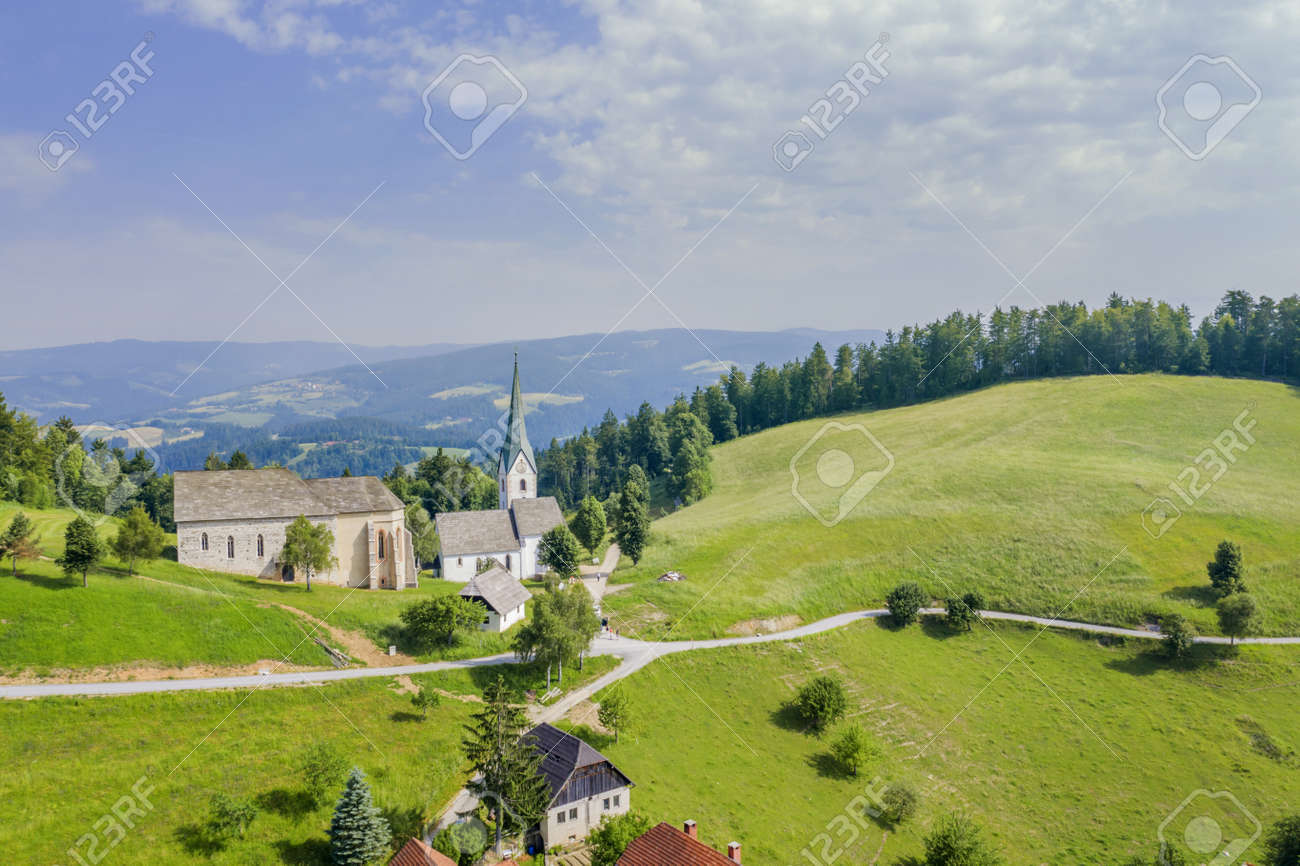 An amazing shot of the Lese church in Slovenia in a valley with a cloudy sky - 155857061