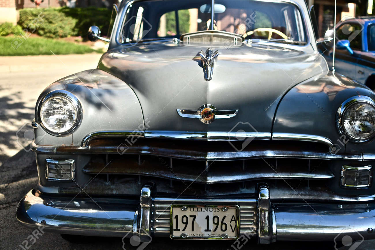 DOWNERS GROVE, UNITED STATES - Jun 07, 2019: A closeup shot of an old retro car in the parking lot in Downers Grove, United States - 157222745