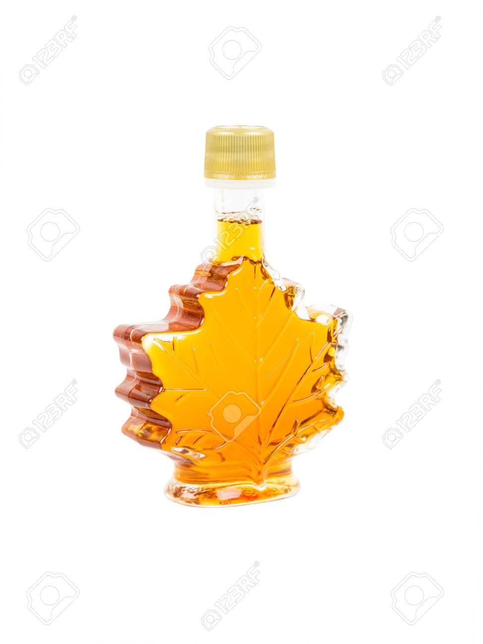 a567849c3e3 Leaf shape maple syrup bottle on white background Stock Photo - 36415623