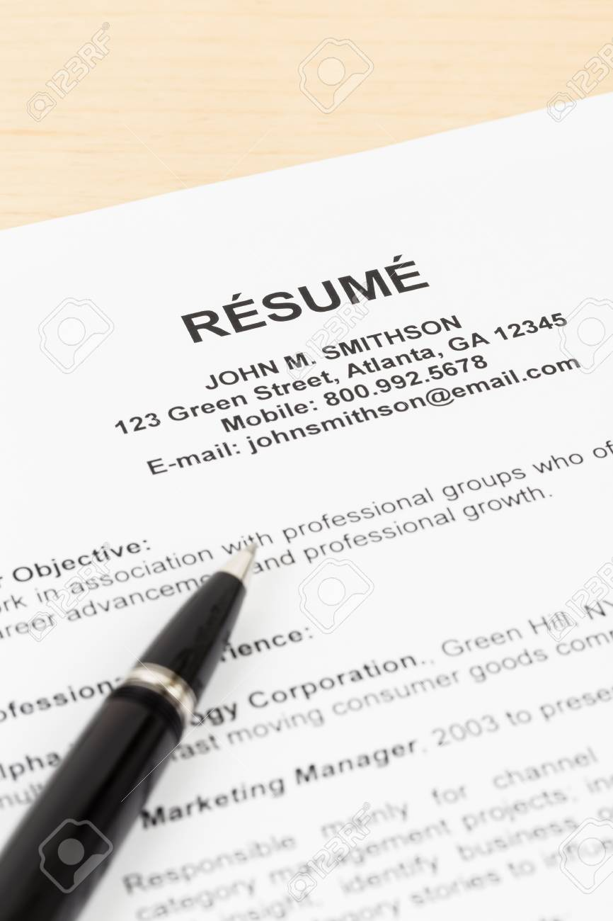 resume with pen resume and information are mockup stock photo