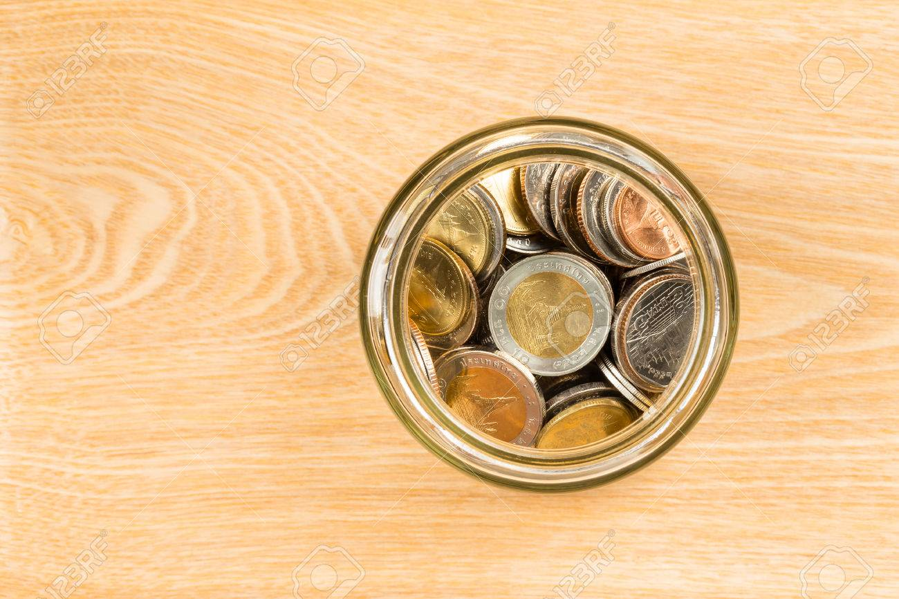 Coin Jar On Wooden Desk Top View Stock Photo, Picture And Royalty ...