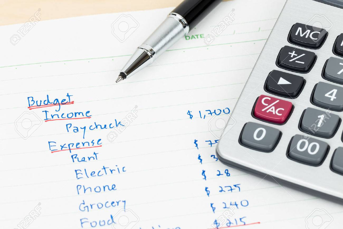 hand writing home budget with calculator stock photo picture and