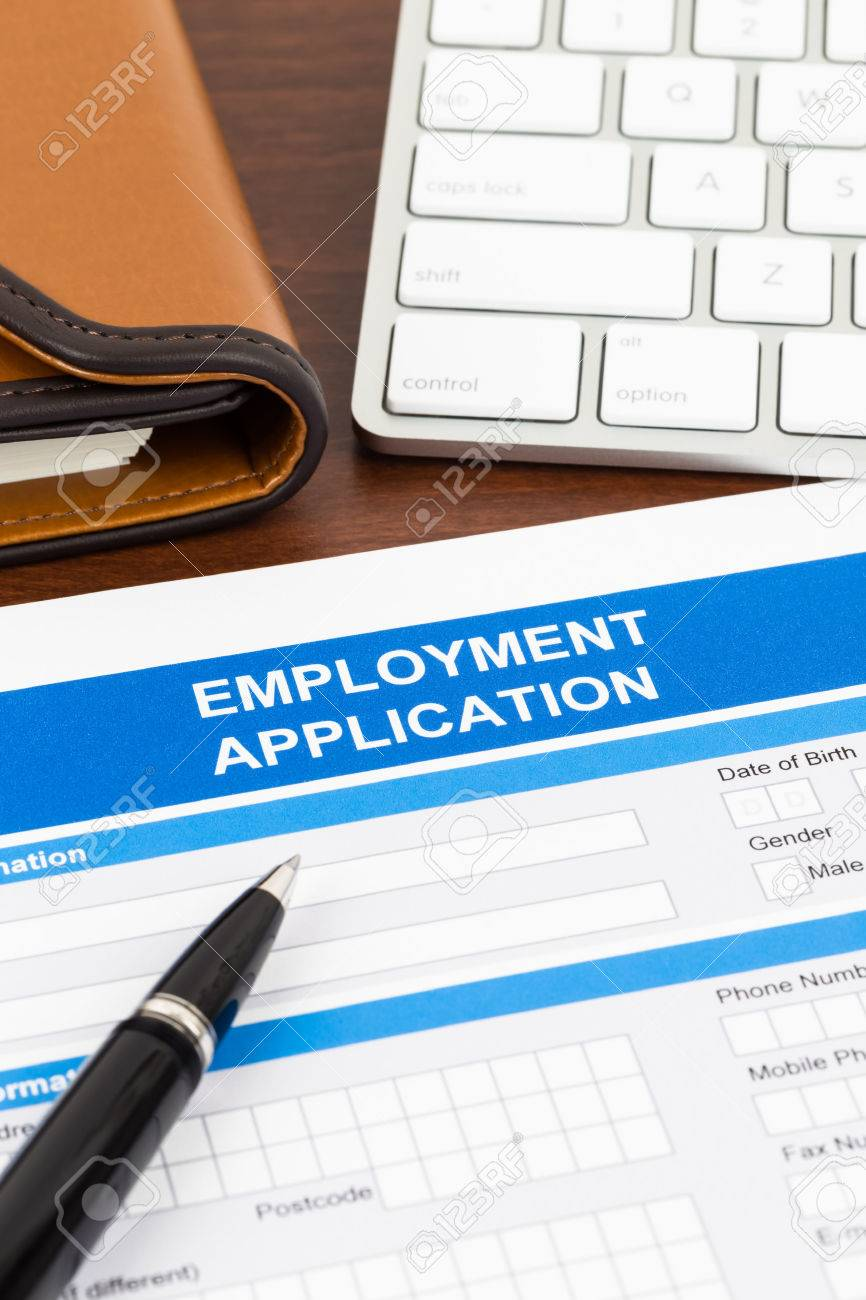 employment application form pen and keyboard document is employment application form pen and keyboard document is mock up stock photo
