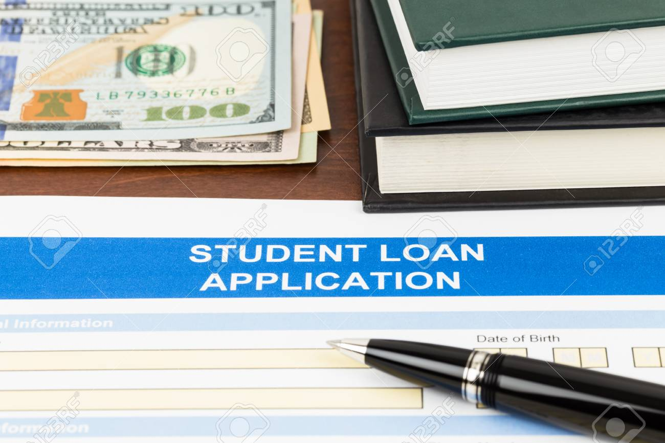 Student Loan Application Form With Pen, Dollar Banknote, And Text Book  Stock Photo