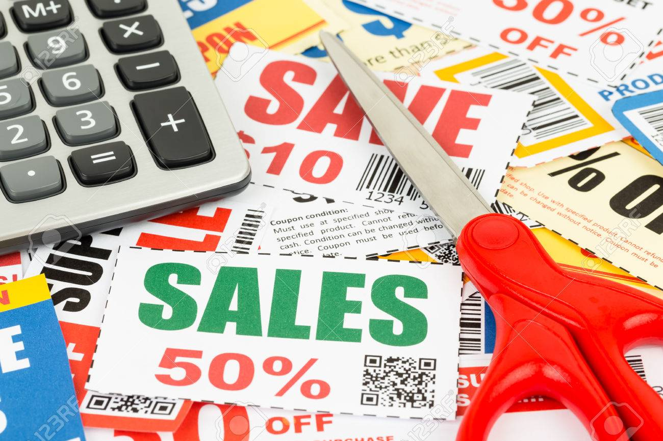 saving discount coupon voucher with scissor and calculator coupons