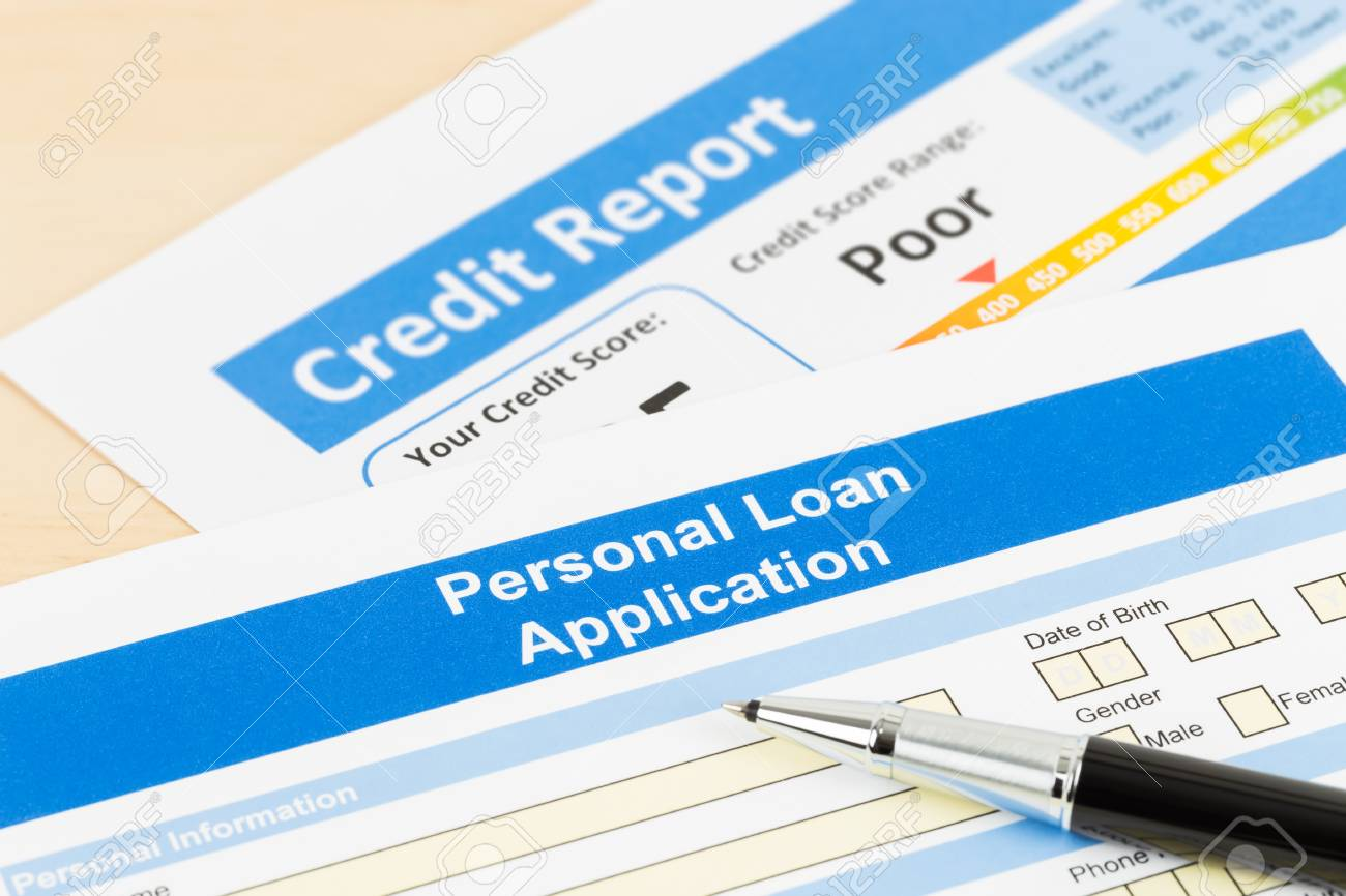Personal Loan Credit Score 550 >> Personal Loan Application Form Poor Credit Score With Pen Stock
