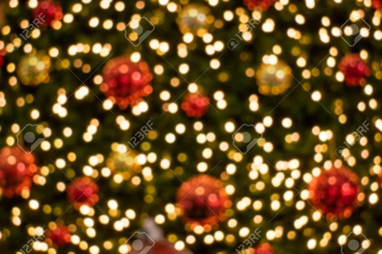 Christmas Tree Background.Blurry Light Decorated Christmas Tree Background