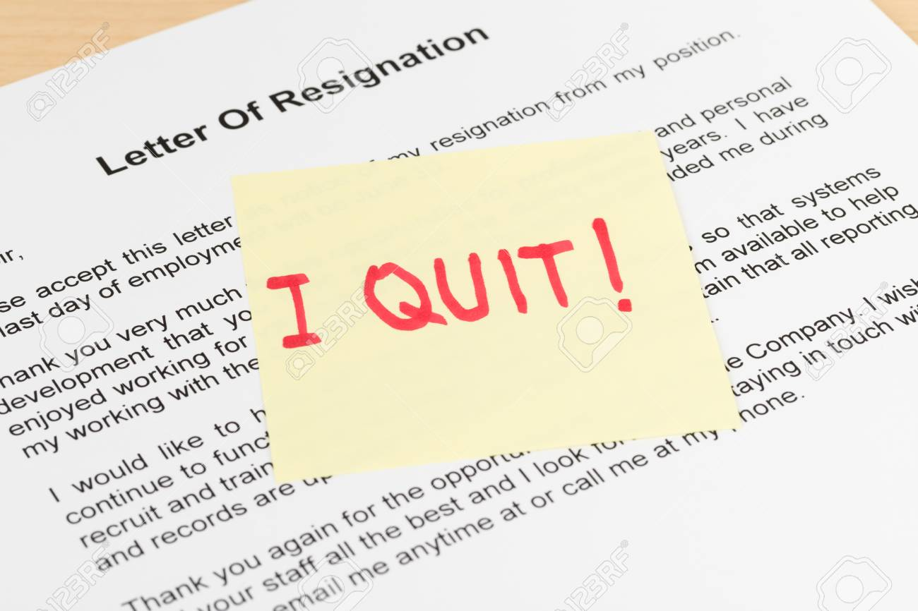 resign quit notice on sticky note resignation letter stock photo