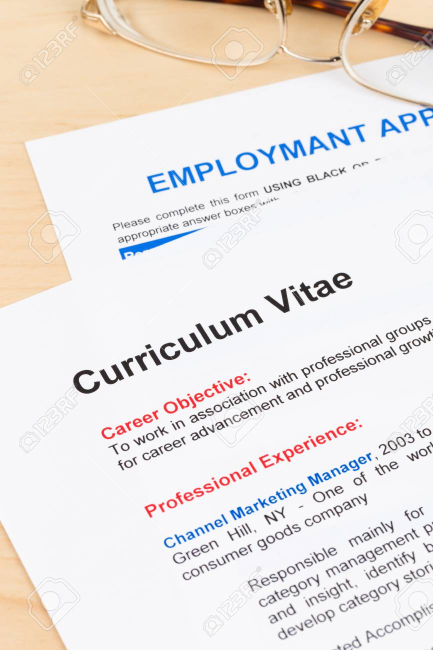 Curriculum Vitae And Employment Application Form With Glasses Stock