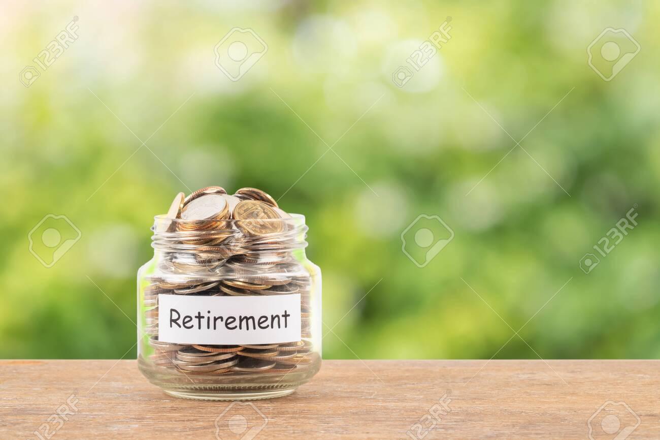 Money coin jar on white background retirement saving concept - 139665704