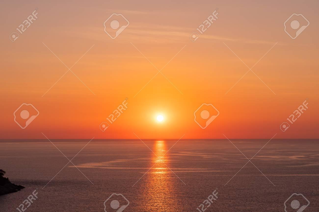 Beautiful sunset on Andaman sea at Windmill View Point near Laem Promthep Cape, Phuket, Thailand - 122847352