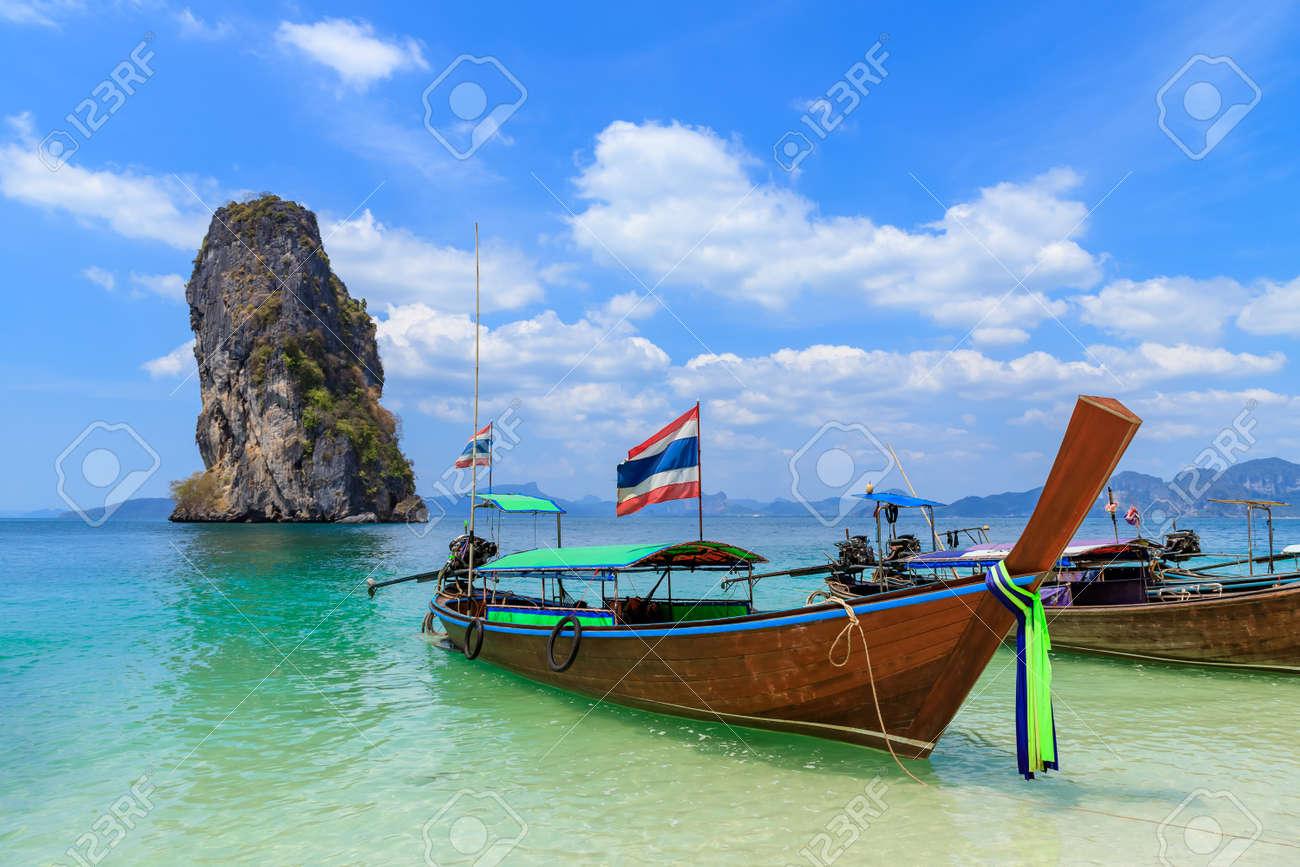 Beautiful crystal clear turquoise blue sea and boats at Ko Poda Island, Ao Phra Nang bay, Krabi, Thailand - 126869263
