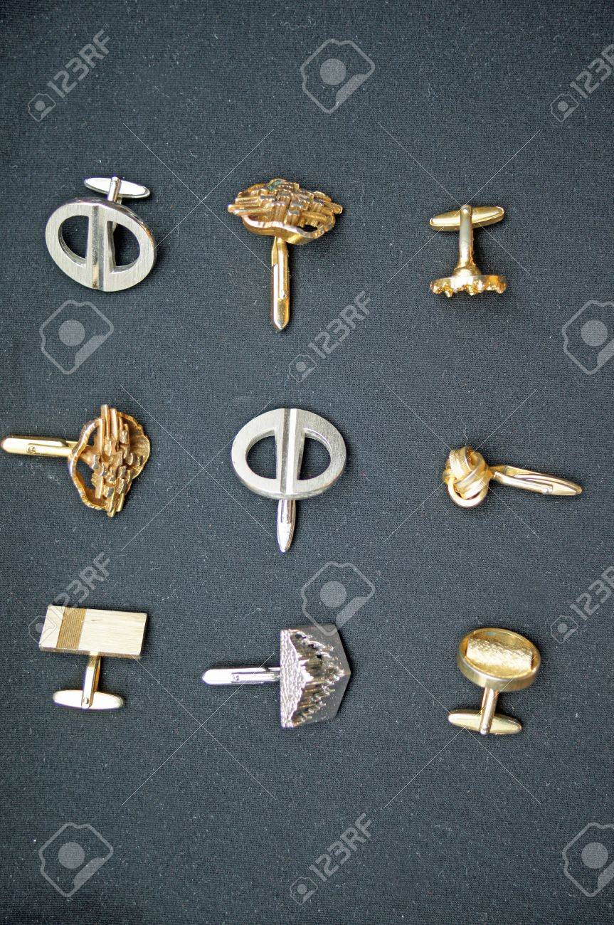 nine golden and silver cufflinks with black background. Stock Photo - 9622133