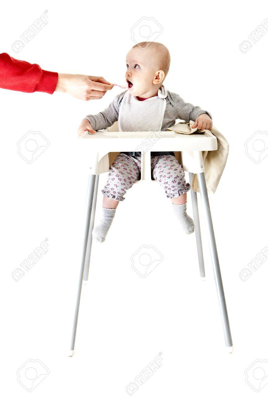 baby in seat and eating Stock Photo - 13400048