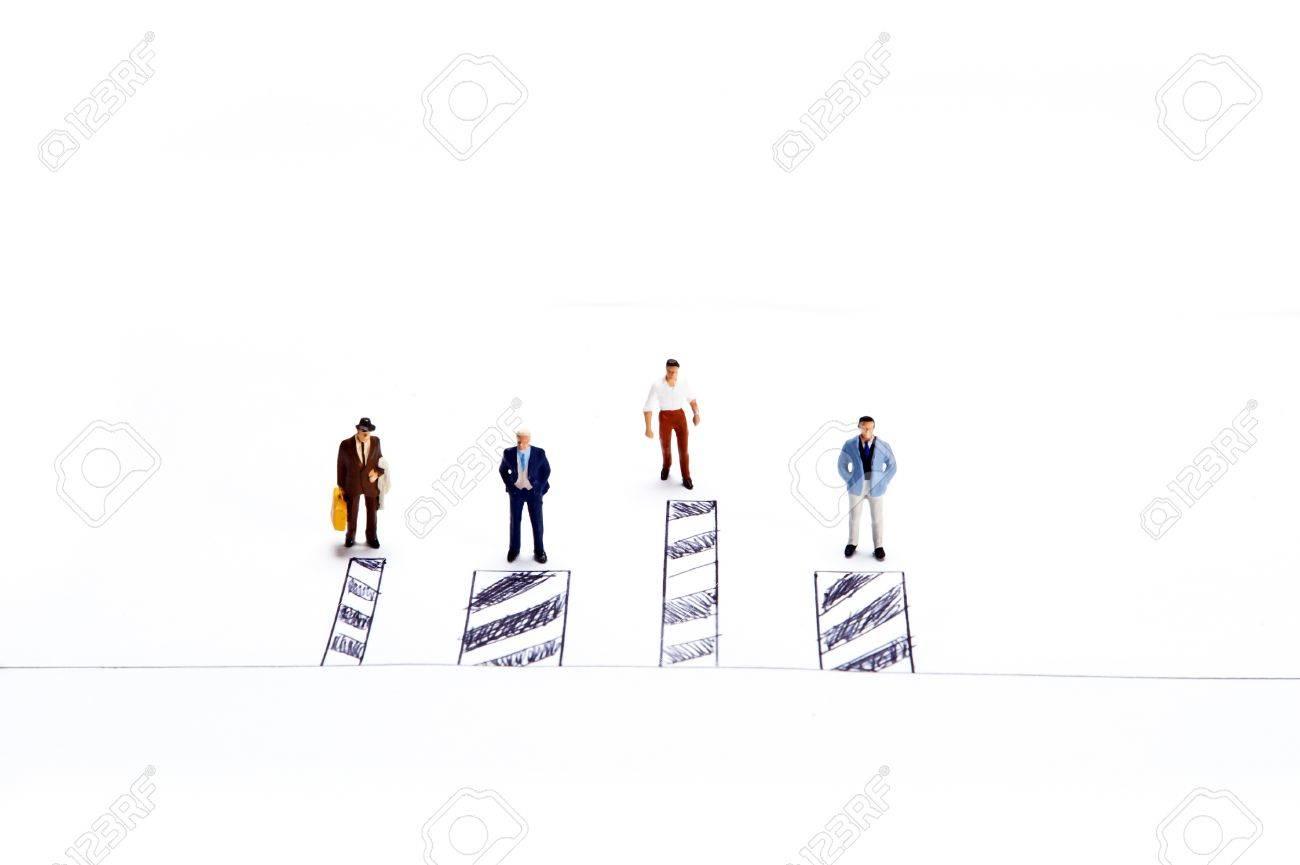 Miniature people on white background Stock Photo - 16256618
