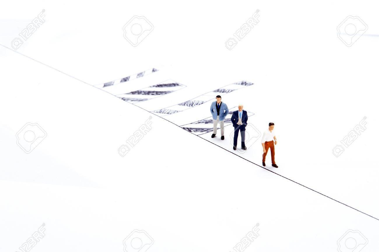 Miniature people on white background Stock Photo - 16256613