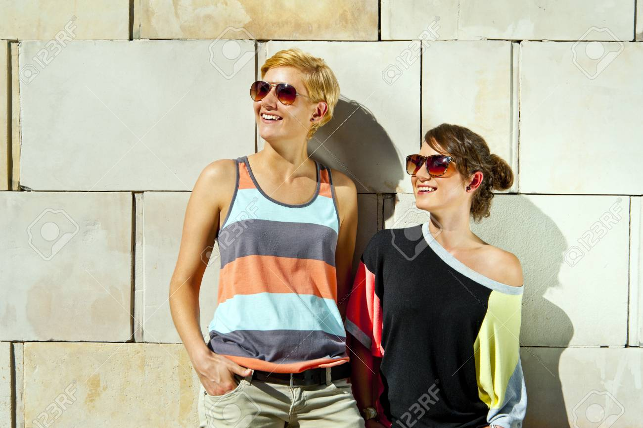 Two  beautiful woman with sunglasses Stock Photo - 16375055