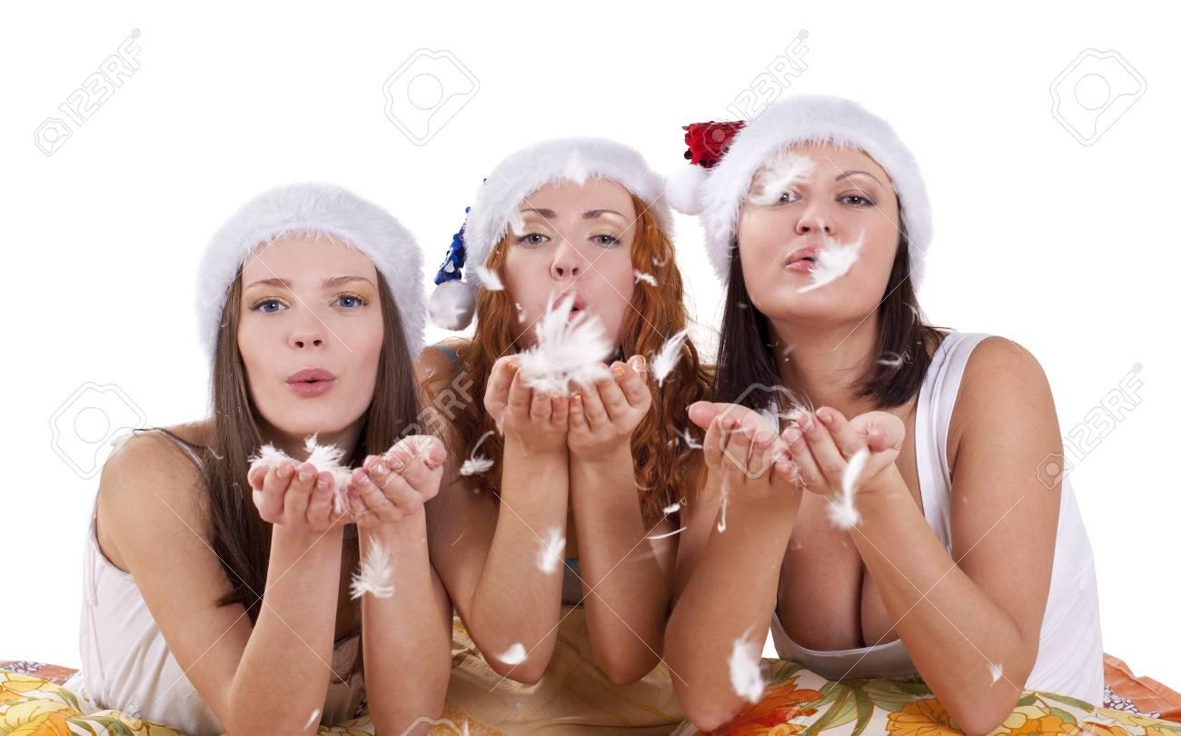 Three woman blow fluff on you - christmas theme Stock Photo - 9070026