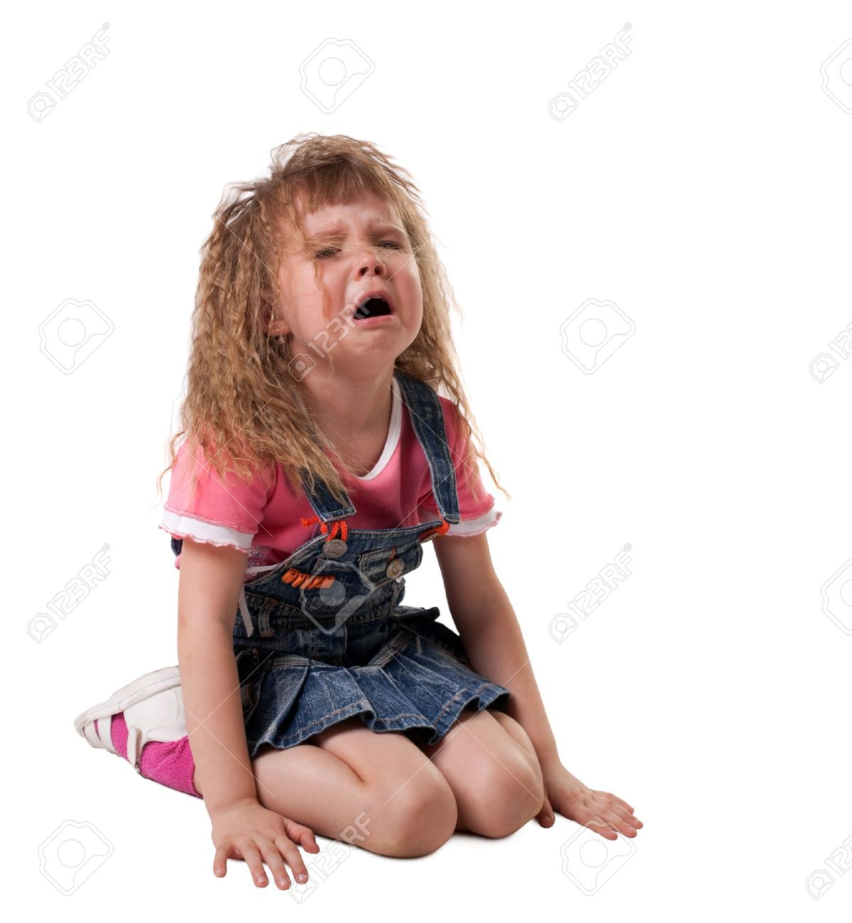 crying kid sit on white, jeans cloth - isolated Stock Photo - 9479817
