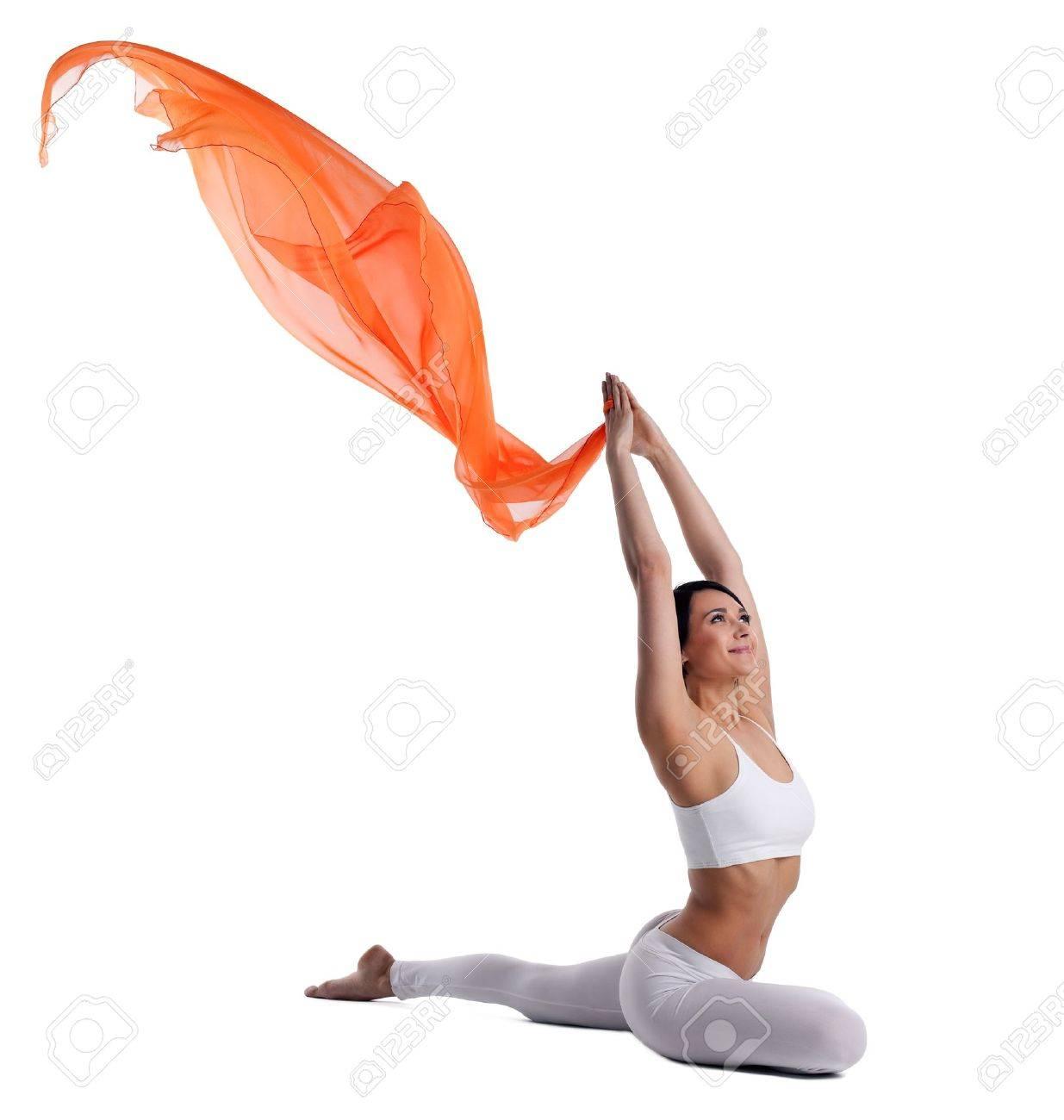 Young Beauty Woman In Yoga Asanas Und Orange Stoff - Taube Pose ...