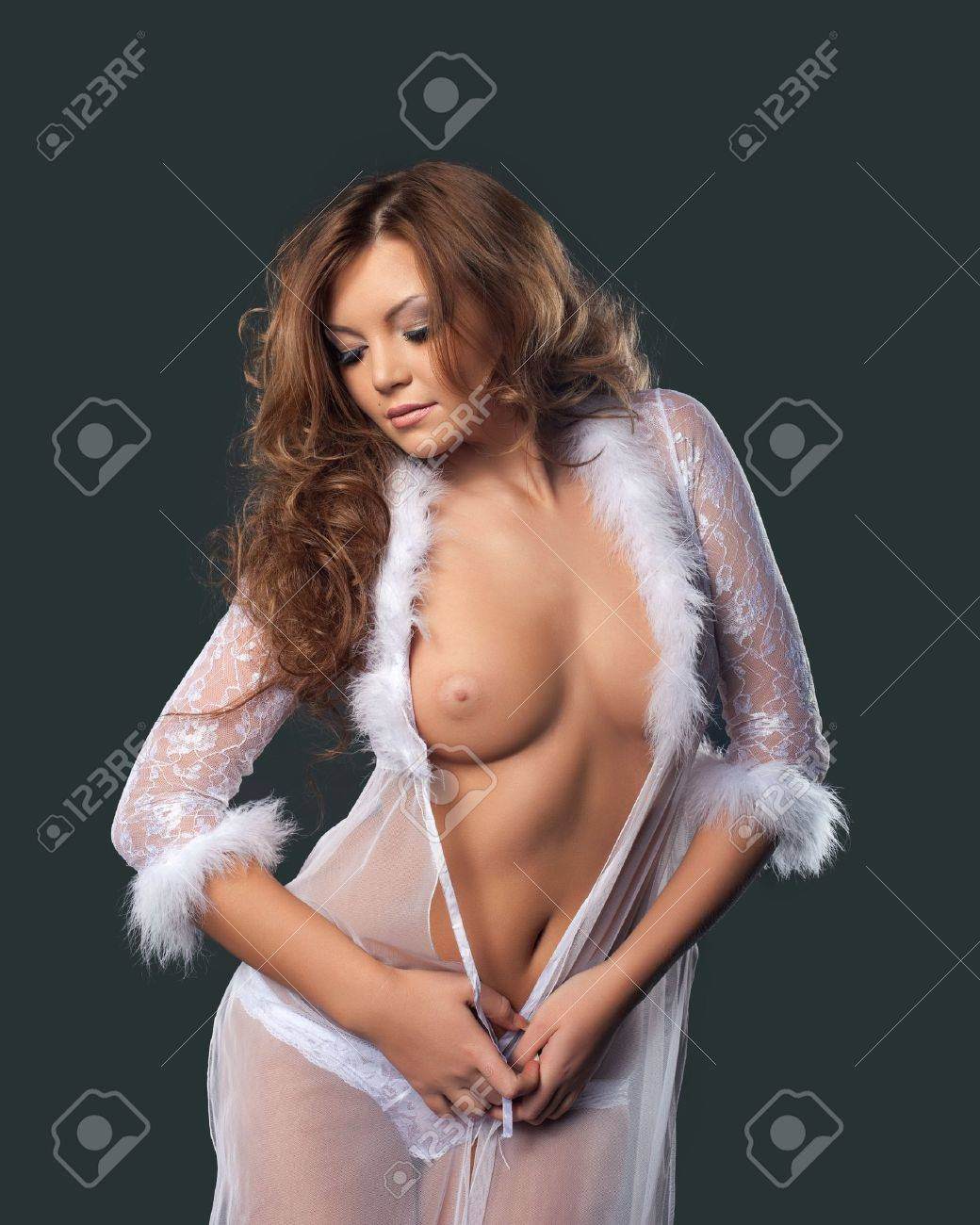 Sexy girl in white lingerie posing - look at camera Stock Photo - 11566877