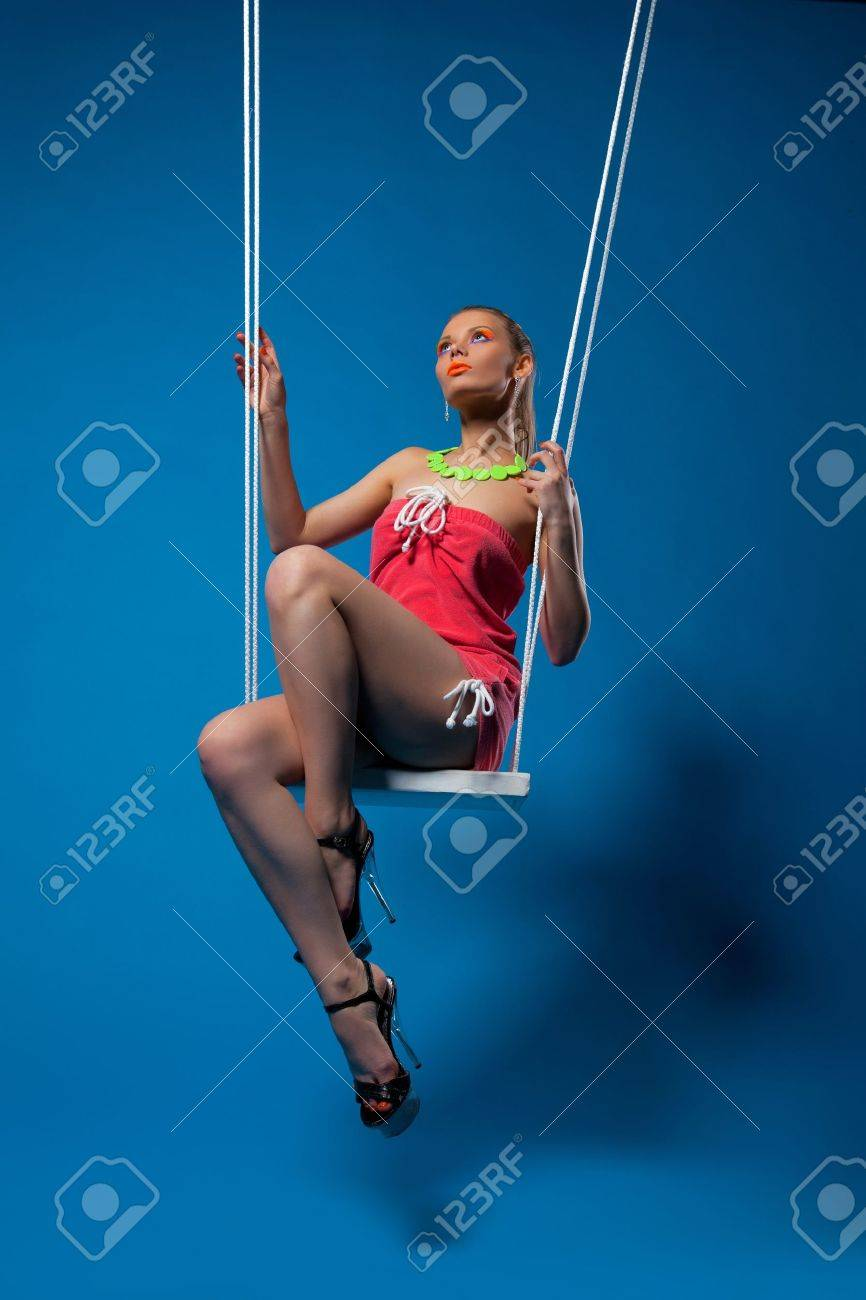 Beautiful girl with glow make-up sit on swing Stock Photo - 13125449