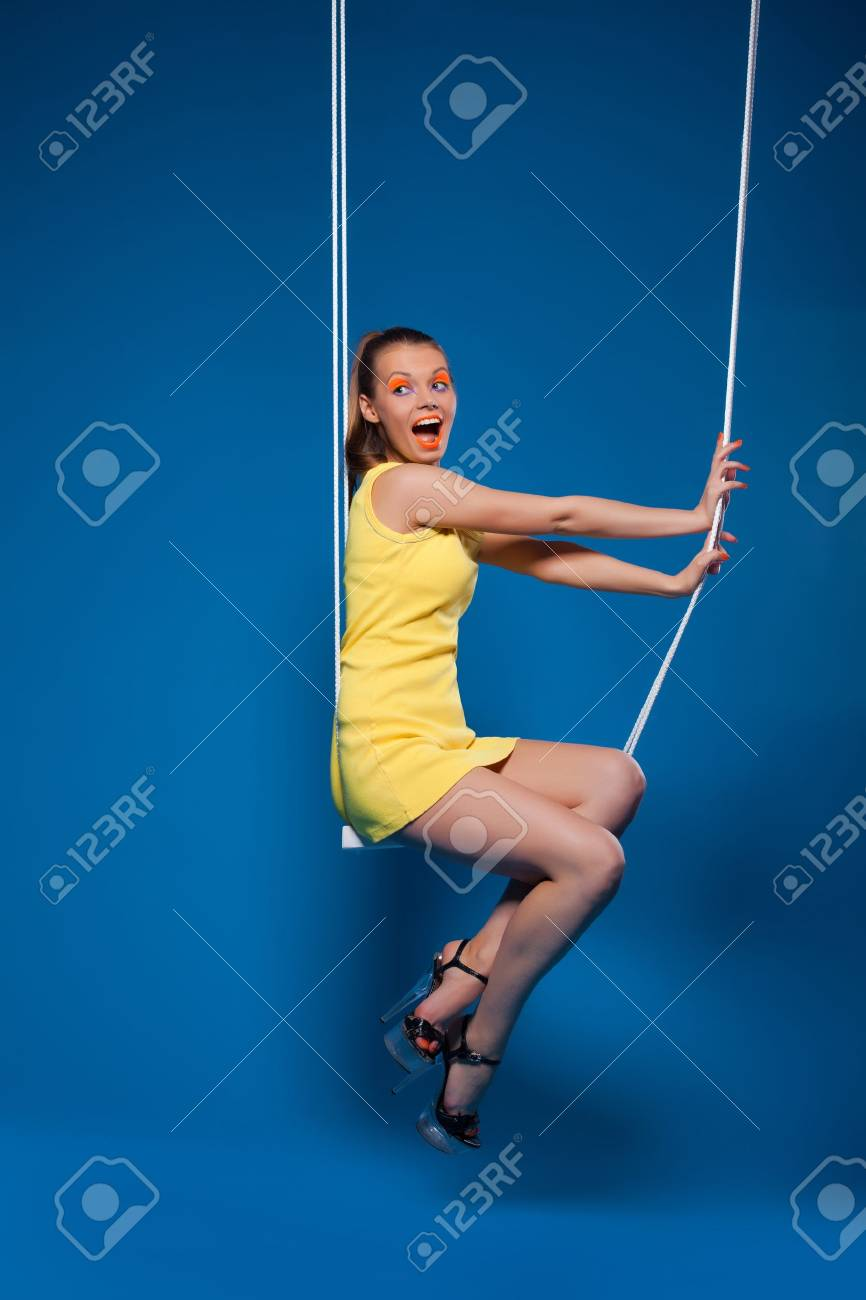 Sexy woman smile on swing with uv make-up pinup style