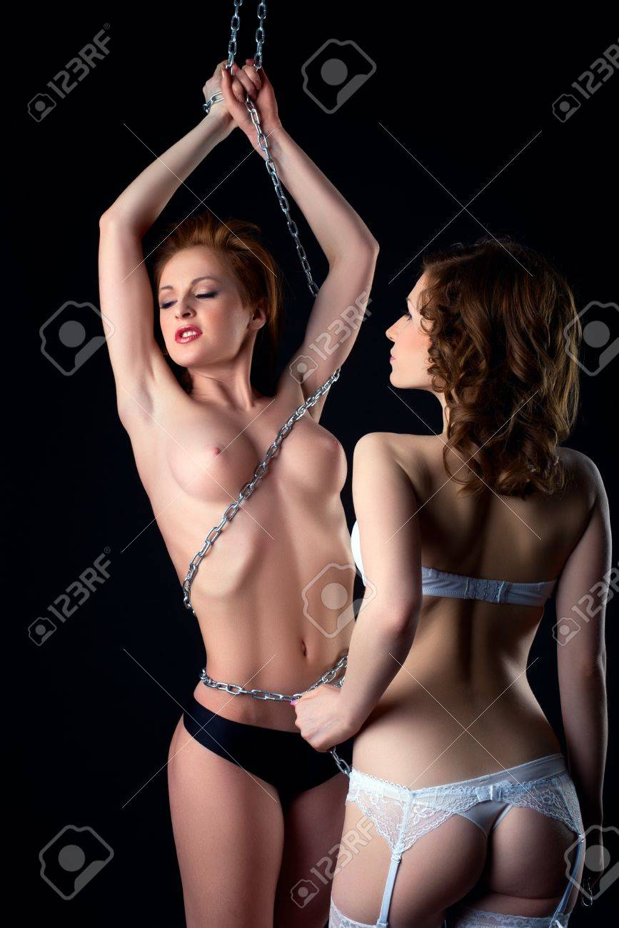 two beauty woman play in ligerie with chain- lesbian game Stock Photo - 13254877