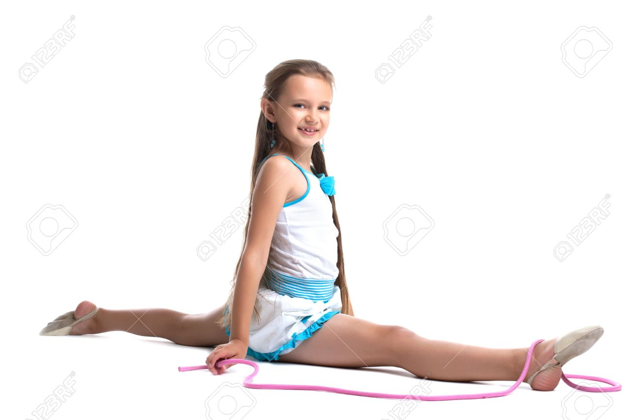 gymnastic kids kids gymnastics: Young kid gymnast doing split with skipping rope isolated