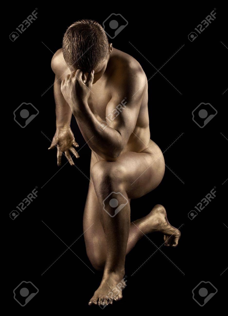 Naked strong man posing in metallic skin make-up Stock Photo - 15422624