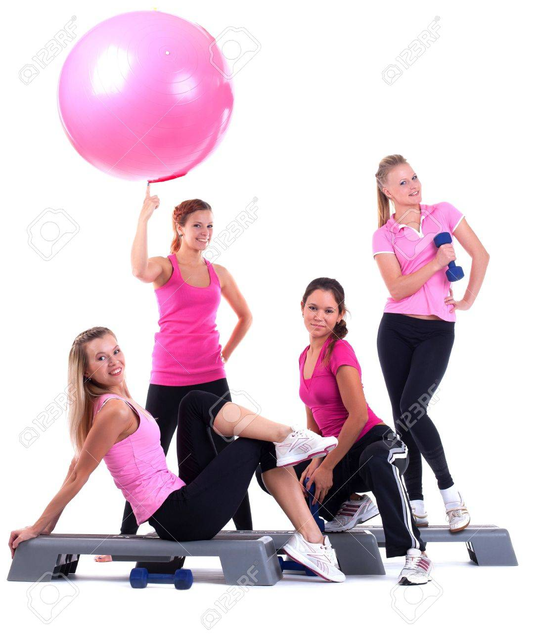 young group women fitness instructor on stepper with accessories isolated - 15427223