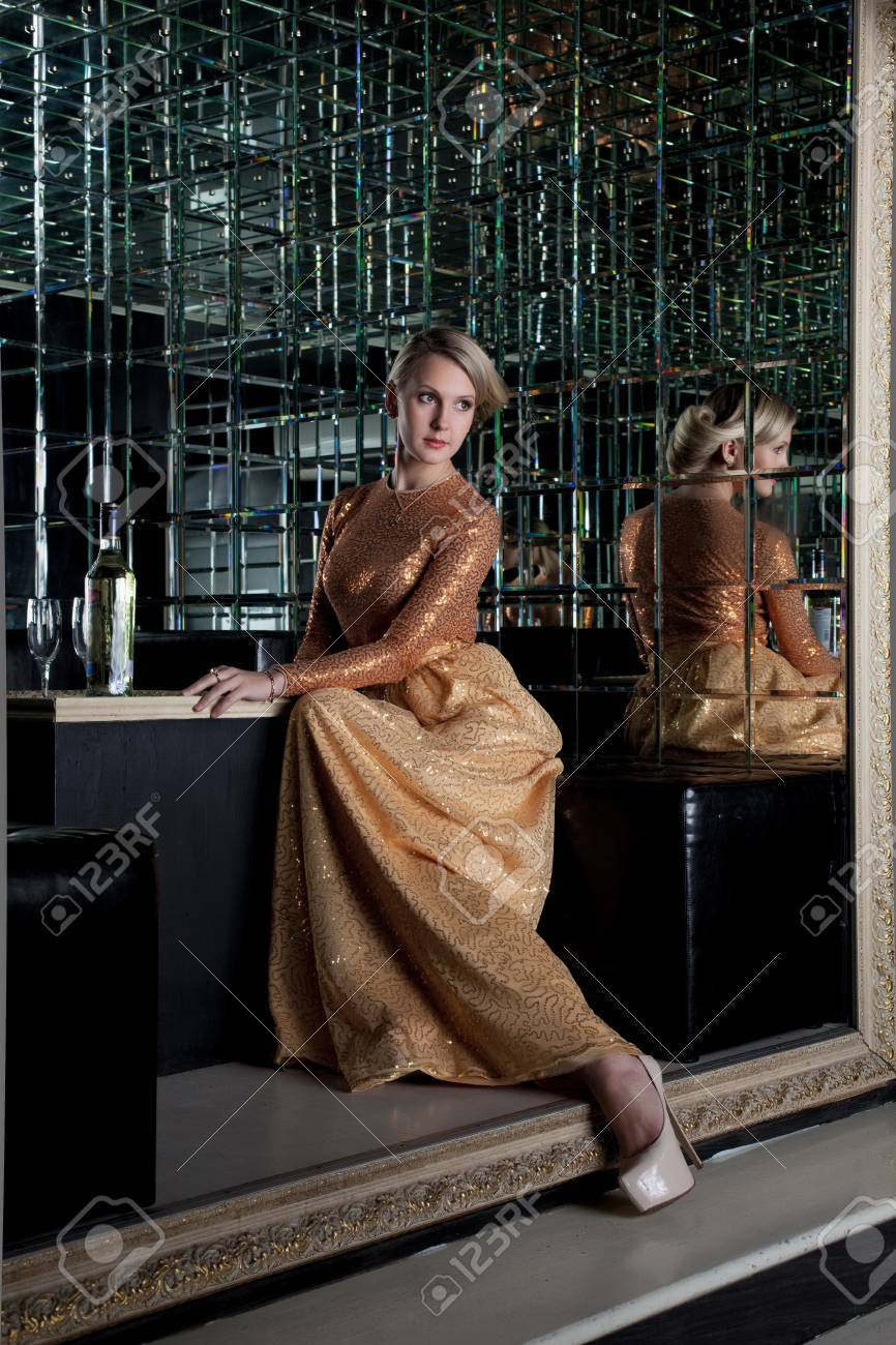 Full length portrait of woman sitting on sofa in club Stock Photo - 17255339